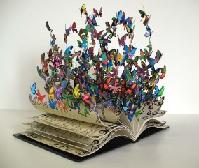 the-book-of-life-a-colorful-metal-art-sculpture-by-david-kracov-that-depicts-a-book-dissolving-into-butterflies