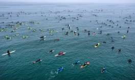 "Hundreds of surfers paddle into place just north of the Huntington Beach Pier in Huntington Beach as they create the world's largest paddle out ""Surfing Circle of Honor"" in Huntington Beach Tuesday morning, June 20, 2017. (Photo by Mark Rightmire, Orange County Register/SCNG)"